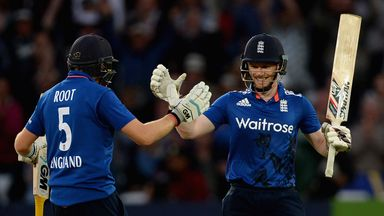 England captain Eoin Morgan celebrates with Joe Root after reaching his century