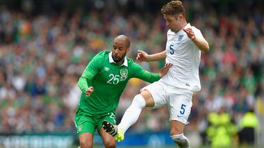 Gary Cahilll challenges David McGoldrick during England