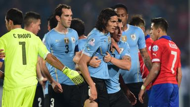 Edinson Cavani: Held back by team-mates after his sending off