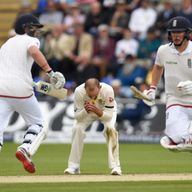 Australia bowler Nathan Lyon (c) reacts as Joe Root and Gary Ballance pick up runs during day one of the 1st Investec Ashes Test