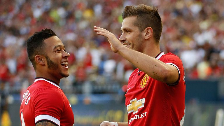 Morgan Scheniderlin (r) celebrates scoring the winner in United's tour opener