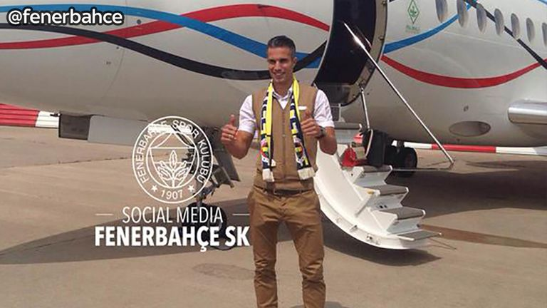 Robin van Persie - on his way to Turkey wearing a 'Fener' scarf