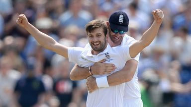 Mark Wood is embraced by James Anderson earlier in this Ashes series
