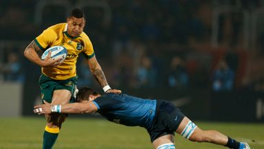 Israel Folau (right) on the attack for Australia