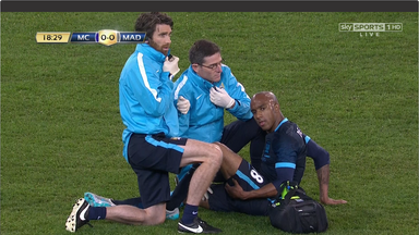 Fabian Delph awaits treatment after being injured against Real Madrid