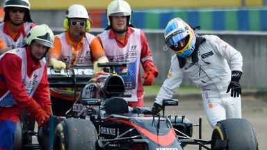 Fernando Alonso pushed his McLaren back to the pits after it broke down in Hungarian GP qualifying