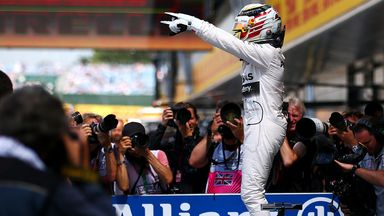 Lewis Hamilton celebrates after taking pole position at Silverstone