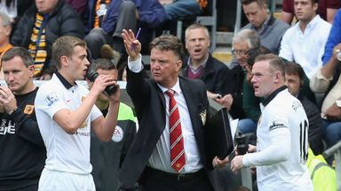 Louis van Gaal with James Wilson (left) and Wayne Rooney (right) - United's main strike force?