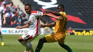 Rob Hall (l) playing for MK Dons during 2014/15 season.