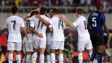 Real Madrid players celebrate Jese's opener against Inter