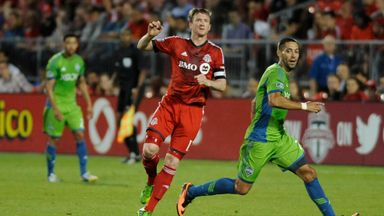 Steven Caldwell in action for Toronto FC against Clint Dempsey and the Seattle Sounders