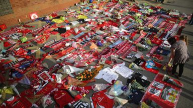 Flowers and football tributes are laid outside Walsall Football Club in memory of, Adrian Evans, Patrick Evans and Joel Richards