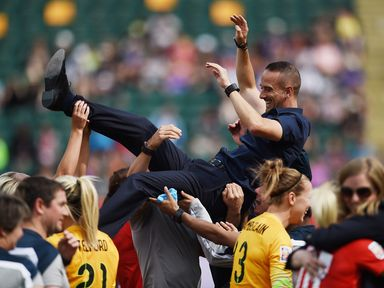 Mark Sampson of England is thrown in the air during the celebrations