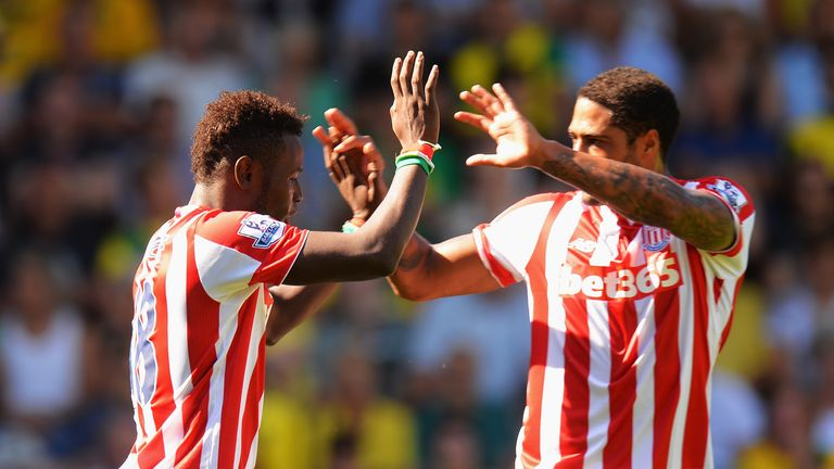 Mame Biram Diouf celebrates alongside Glen Johnson after opening the scoring against Norwich