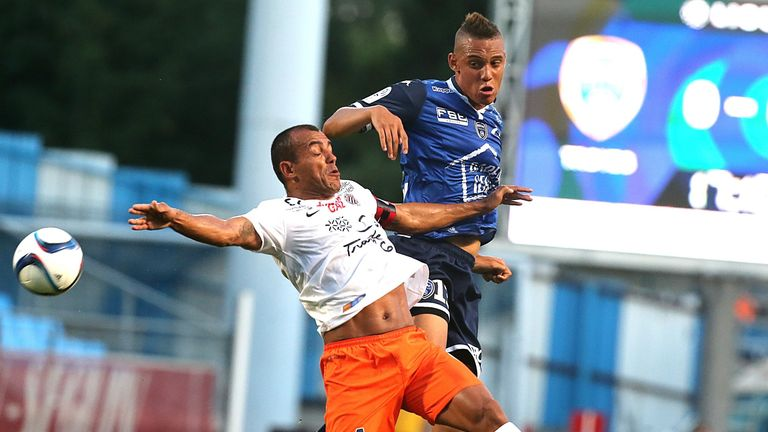 Troyes forward Perea Vargas (right) battles with Montpellier defender Vitorino Hilton