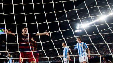 Lionel Messi celebrates Thomas Vermaelen's winning goal