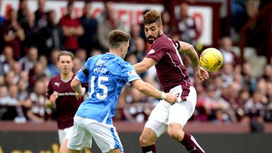 St Johnstone defender Brad McKay (left) was unimpressed with the way Hearts striker Juanma Delgado (right) threw himself around against the Perth side