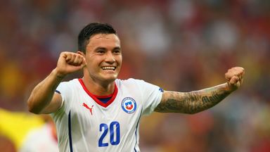 Charles Aranguiz of Chile celebrates scoring against Spain during the 2014 FIFA World Cup