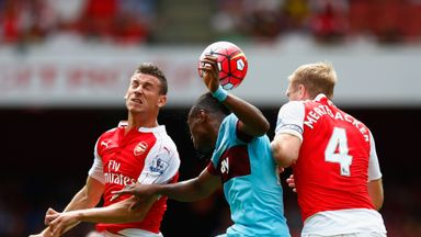 Laurent Koscielny and Per Mertesacker in action for Arsenal against West Ham on opening weekend