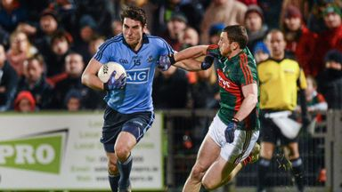 Bernard Brogan takes on Keith Higgins during Dublin's National League win over Mayo last March
