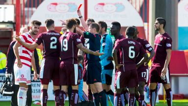 Hearts' Callum Paterson (second from left) receives a red card for his foul on Hamilton's Darian MacKinnon