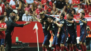 Atletico Madrid manager Diego Simeone celebrates with his team after Jackson Martinez's first goal