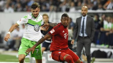 Bayern Munich defender Jerome Boateng (R) and Wolfsburg's Daniel Caligiuri