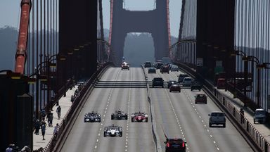 Indy cars, lead by Marco Andretti in the #25 car, drive across the Golden Gate Bridge