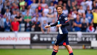 Daryl Janmaat walks off the pitch after receiving a red card against Swansea