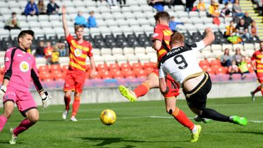 Adam Rooney scores for Aberdeen to put them ahead at Partick Thistle