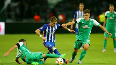 Peter Pekarik (C) of Berlin battles for possession against Werder Bremen.