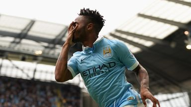 Raheem Sterling celebrates after scoring his first Premier League goal for Man City