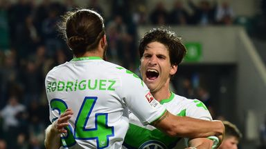 Wolfsburg's Timm Klose (R) celebrates with Ricardo Rodriguez after scoring