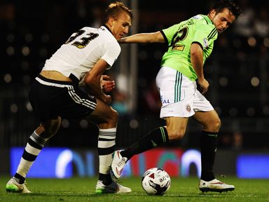 Dan Burn of Fulham and Marc McNulty of Sheffield United challenge for the ball