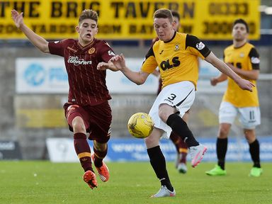 Motherwell's Jack Leitch closes down Pat Slattery (right)
