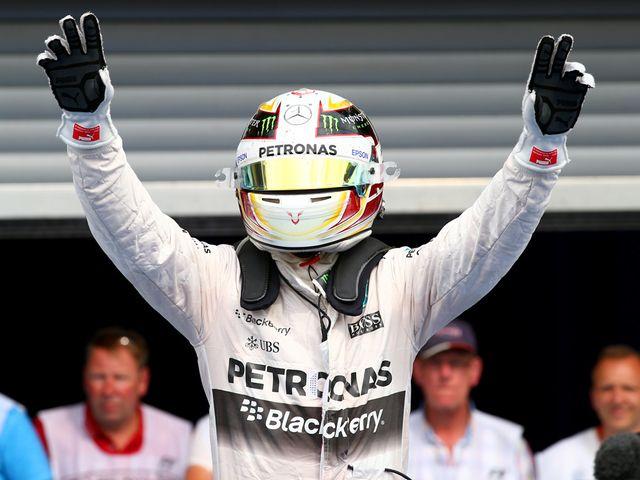 Lewis Hamilton celebrates after winning the Belgian Grand Prix