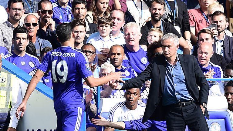 Jose Mourinho shakes hands with Diego Costa after he is substituted in the game against Arsenal