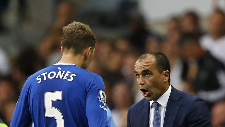 Everton defender John Stones and manager Roberto Martinez