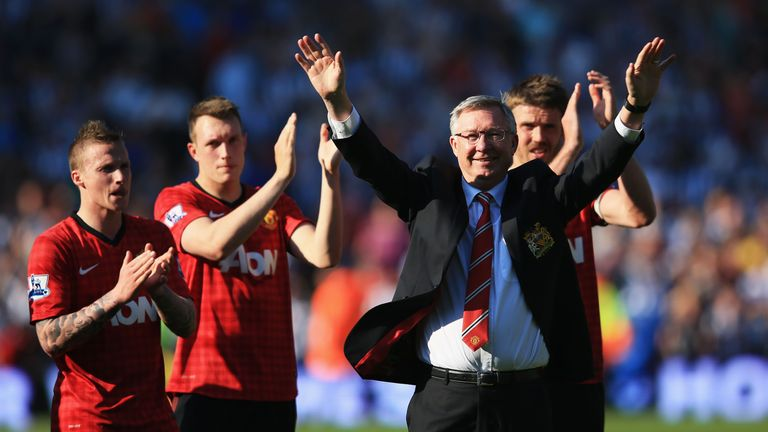 Sir Alex Ferguson is applauded by players after his 1,500th and final match in charge of Man Utd