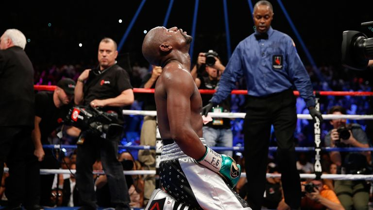 Floyd Mayweather kneels on the mat after beating Andre Berto