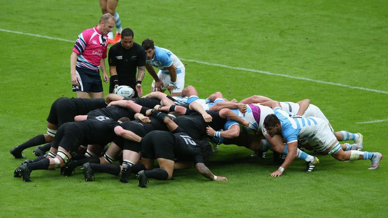 New Zealand display their 'blackest ever' kit during a scrum