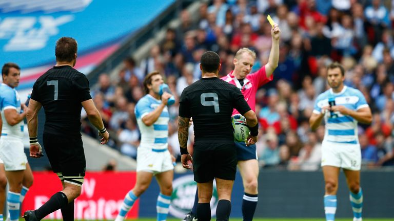 Wayne Barnes shows Richie McCaw a yellow card during the Pool C match between New Zealand and Argentina at Wembley Stadium