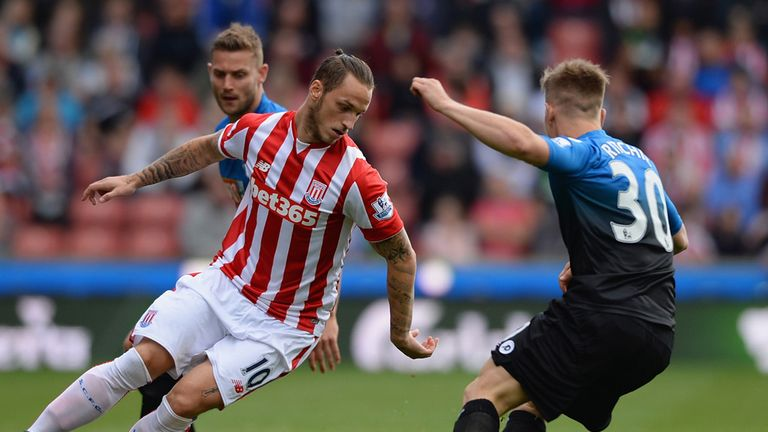 Marko Arnautovic (left) takes on Matt Ritchie
