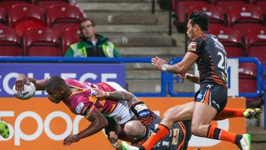 Huddersfield's Jermaine McGillvary slams over for a try