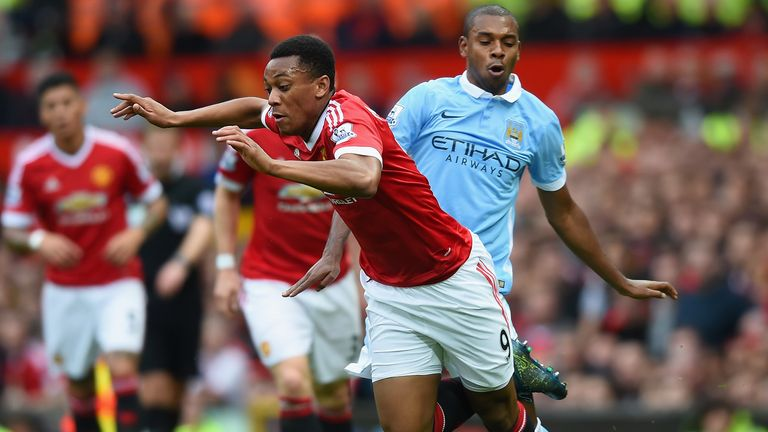 Anthony Martial of Manchester United is challenged by Fernandinho of Manchester City