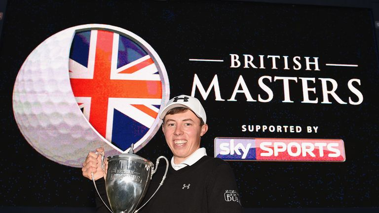 Matthew Fitzpatrick shows off his first trophy as a professional