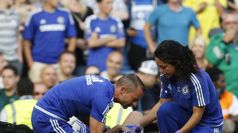 Carneiro and head physio Jon Fearn treat Hazard at Stamford Bridge in August