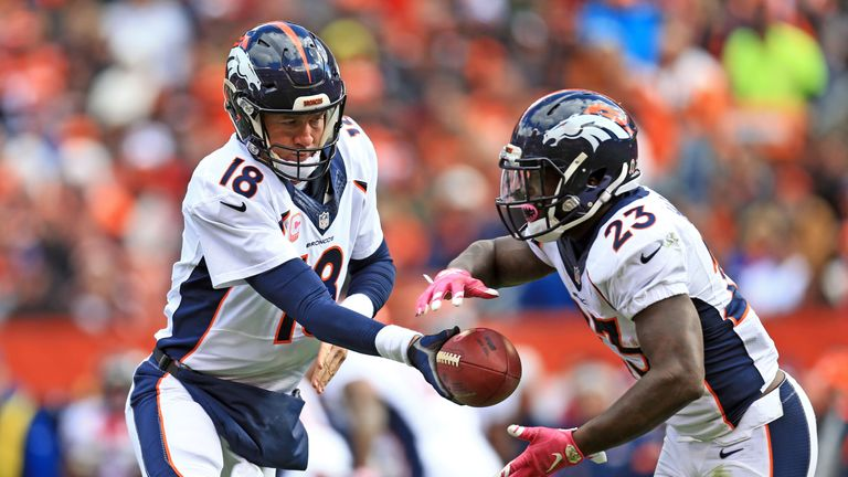 Peyton Manning hands the ball off to Broncos running back Ronnie Hillman