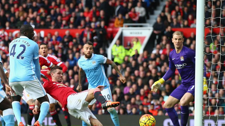 Morgan Schneiderlin lunges for the ball against manchester City