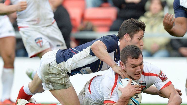 Brett Ferres goes over for a try in last year's game against France